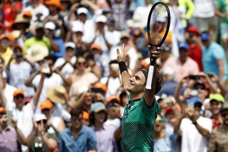 Apr 2, 2017; Key Biscayne, FL, USA; Roger Federer of Switzerland celebrates after his match against Rafael Nadal of Spain in the men's singles championship of the 2017 Miami Open at Crandon Park Tennis Center. Mandatory Credit: Geoff Burke-USA TODAY Sports
