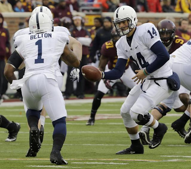 Penn State quarterback Christian Hackenberg (14) hands off the ball to running back Bill Belton (1) during the first quarter of an NCAA college football game against Minnesota in Minneapolis, Saturday, Nov. 9, 2013. (AP Photo/Ann Heisenfelt)