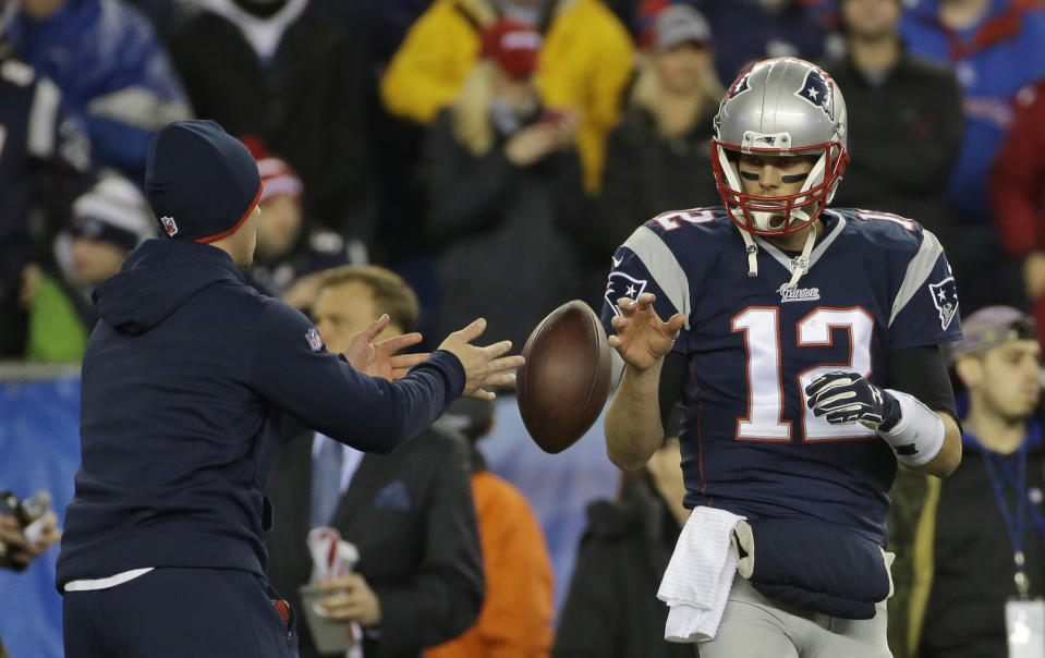 """FILE - In this Sunday, Jan. 18, 2015 file photo, New England Patriots quarterback Tom Brady has a ball tossed to him during warmups before the NFL football AFC Championship game against the Indianapolis Colts in Foxborough, Mass. A federal appeals court has ruled, Monday, April 25, 2016,  that New England Patriots Tom Brady must serve a four-game """"Deflategate"""" suspension imposed by the NFL, overturning a lower judge and siding with the league in a battle with the players union.(AP Photo/Matt Slocum, File)"""