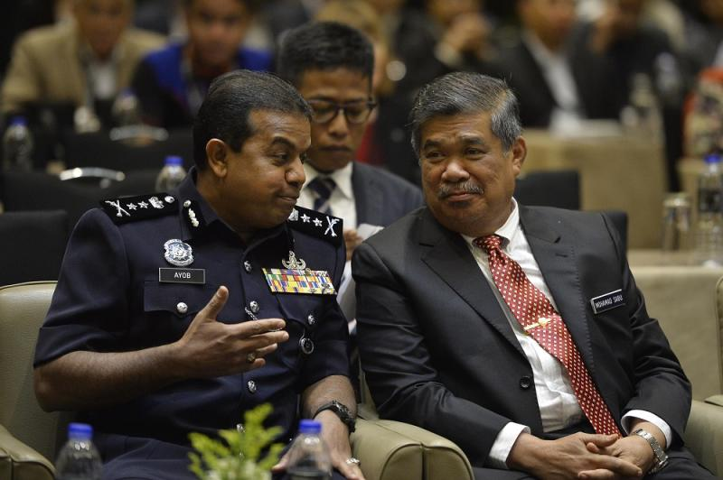 Federal Special Branch Counter Terrorism Division principal assistant director Deputy Commissioner Datuk Ayob Khan Mydin Pitchay (left) and Defence Minister Mohamad Sabu at the International Association of Counterterrorism and Security Professionals counter-terrorism symposium in Kuala Lumpur August 27, 2018. — Picture by Azinuddin Ghazali