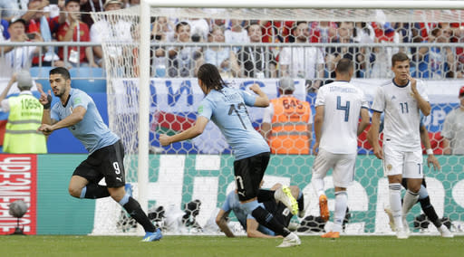 Uruguay's Luis Suarez, left, celebrates after scoring the opening goal during the group A match between Uruguay and Russia at the 2018 soccer World Cup at the Samara Arena in Samara, Russia, Monday, June 25, 2018. (AP Photo/Gregorio Borgia)