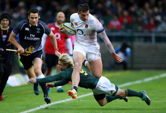 Rugby Union - Third Test International - South Africa v England - Newlands Stadium, Cape Town, South Africa - June 23, 2018. England's Jonny May is tackled by South Africa's Faf de Klerk. REUTERS/Mike Hutchings