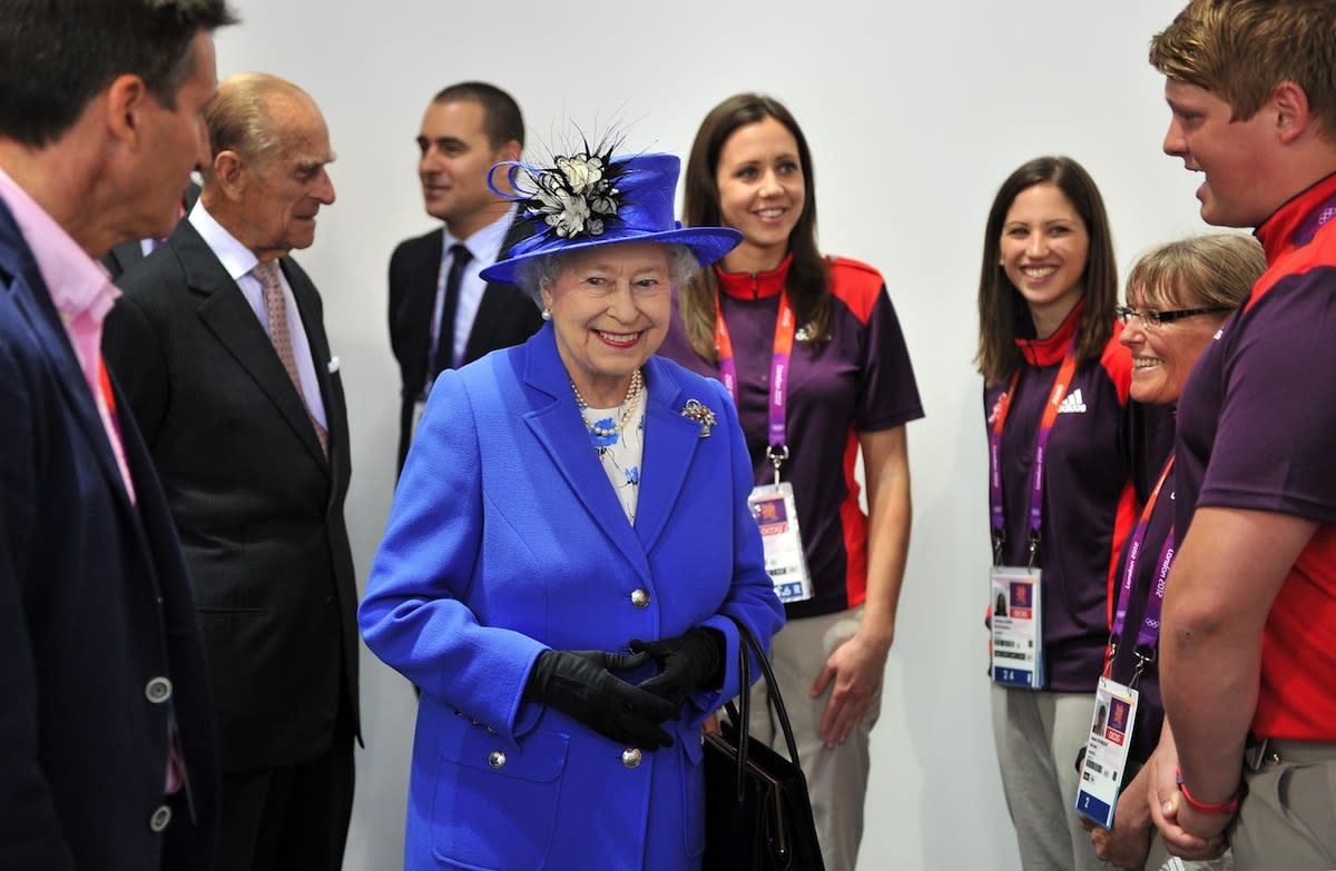 Queen Elizabeth II    She may have looked a little glum during the opening ceremonies, but Queen Elizabeth II was all smiles in royal blue as she met with some of Great Britain's athletes and Olympic volunteers later in the week. Her Majesty visited the Athletes Village along with her husband, Prince Phillip, shaking hands with competitors from Great Britain and around the world.    (Photo by Martin Rickett/WPA Pool/Getty Images)