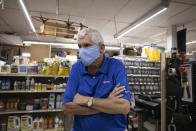 "Fred Byrnside, owner of Byrnside Hardware, speaks with an Associated Press reporter in his store in Danville, W.Va., on Tuesday, Oct. 13, 2020. Business has fallen off in the store he has run for 30 years. Since 2014, West Virginia has lost nearly a third of its remaining full-time coal jobs as production declines. ""There was a time when 24-year-olds were getting jobs here in the mines,"" Byrnside said. (AP Photo/Chris Jackson)"