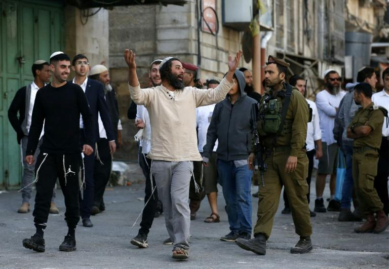 Israeli settlers in Hebron are protected by a strong presence of security forces