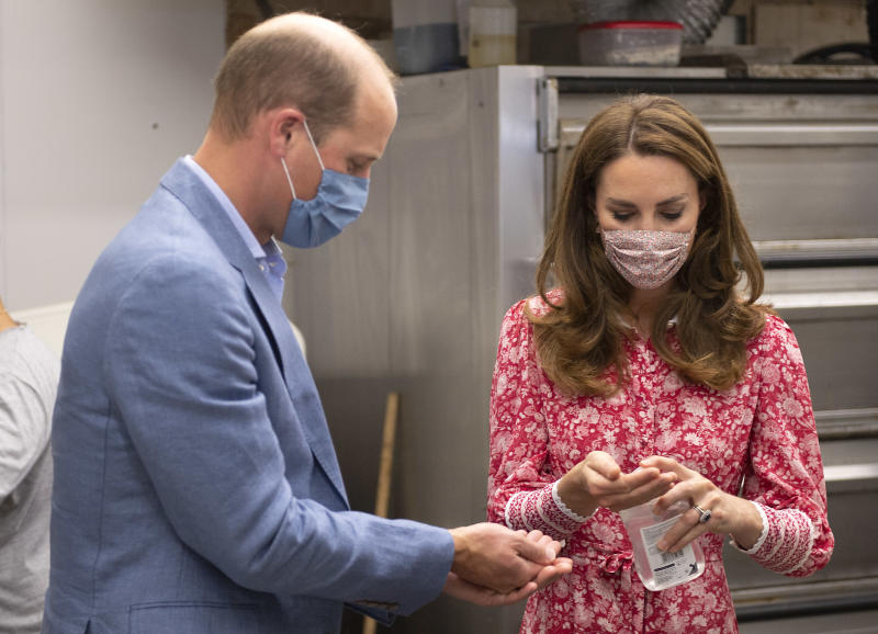 Britain's Prince William, Duke of Cambridge and his wife Britain's Catherine, Duchess of Cambridge use an anti-bacterial hand gel to sanitise their hands during a visit to Beigel Bake Brick Lane Bakery in east London on September 15, 2020. - The 24-hour bakery was forced to reduce their opening hours during the pandemic and The Duke and Duchess heard how this affected employees, as well as the ways in which the shop has helped the local community through food donation and delivery. (Photo by JUSTIN TALLIS / various sources / AFP) (Photo by JUSTIN TALLIS/AFP via Getty Images)