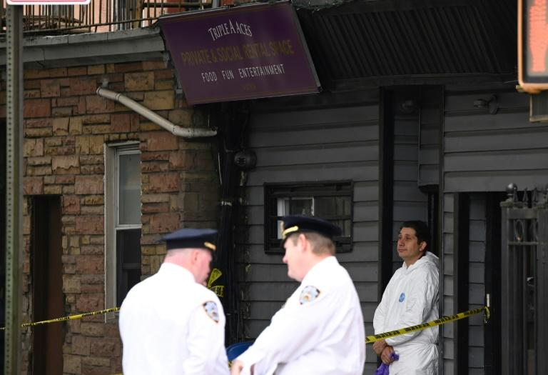New York police stand outside the Triple A Aces Private & Social Rental Place after a shooting took place inside the club (AFP Photo/Johannes EISELE)