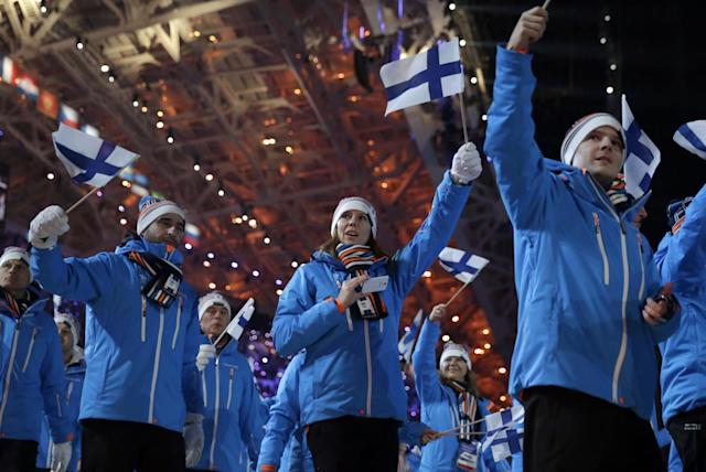 Members of the Finnish team enter the stadium during the opening ceremony of the 2014 Winter Olympics in Sochi, Russia, Friday, Feb. 7, 2014. (AP Photo/Matt Dunham)