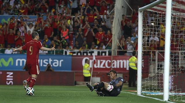 Spain's Fernando Torres, left, celebrates after scoring against Bolivia as Bolivia's goalkeeper Roquel Quinonez reacts during their friendly soccer match in Seville, on Friday, May 30. 2014. (AP Photo/Miguel Angel Morenatti)