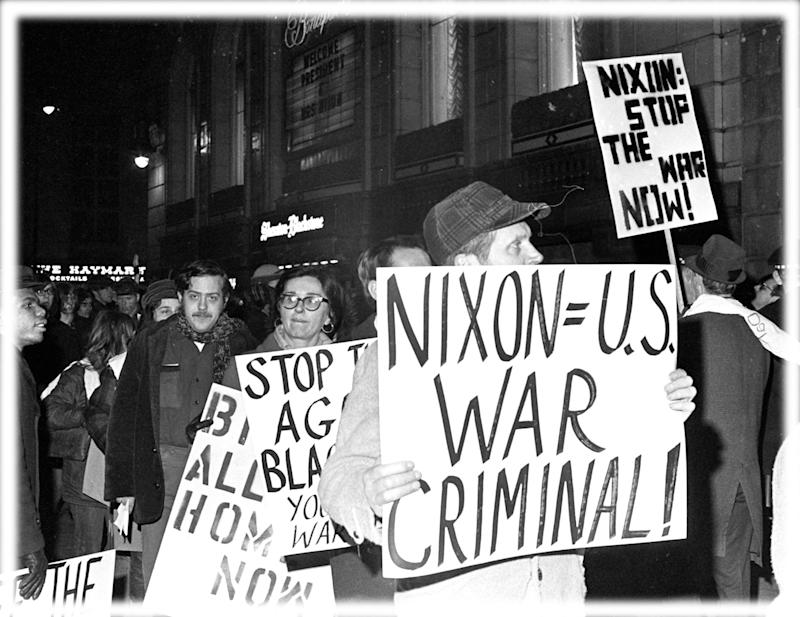 Protesters against the policies of President Richard Nixon. (Photo: AP; digitally enhanced by Yahoo News)