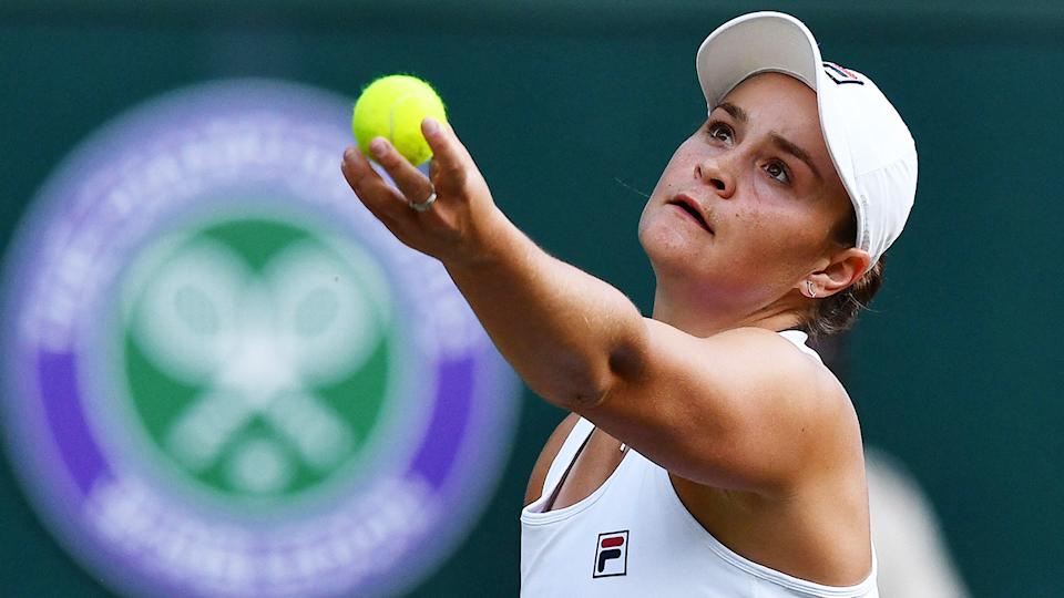 Ash Barty concentrates as she prepares to serve during at match at the 2021 Wimbledon tournament.
