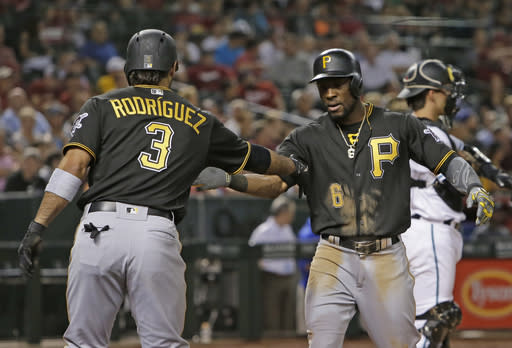 Pittsburgh Pirates' Starling Marte celebrates with Sean Rodriguez (3) after hitting a three-run home run against the Arizona Diamondbacks during the fourth inning of a baseball game Tuesday, June 12, 2018, in Phoenix. (AP Photo/Rick Scuteri)
