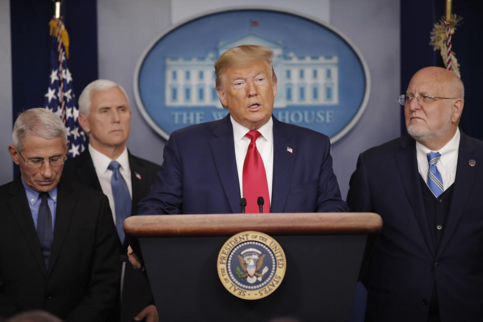 President Donald Trump, center, speaks to members of the media to address the nation about the coronavirus threat in the Brady Press Briefing room of the White House in Washington, Saturday, Feb. 29, 2020. With Trump are from l-r., National Institute for Allergy and Infectious Diseases Director Dr. Anthony Fauci, Vice President Mike Pence and CDC Director Robert Redfield.(AP Photo/Carolyn Kaster)