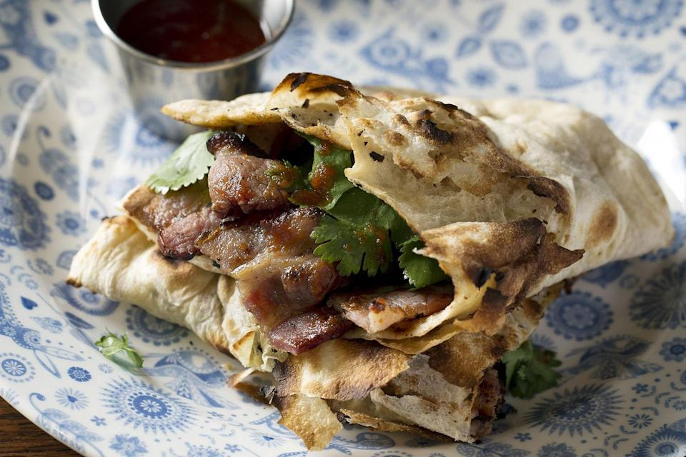 'Having naan of it': Dishoom have accused M&S of not giving the chain credit for it's famous Bacon Naan roll (Dishoom)