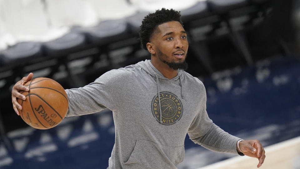 Utah Jazz guard Donovan Mitchell warms up before the start of their NBA basketball game against the Memphis Grizzlies Sunday, May 23, 2021, in Salt Lake City. The Utah Jazz announced that All-Star guard Mitchell will miss Game 1 of their first-round playoff series against the Memphis Grizzlies. (AP Photo/Rick Bowmer)