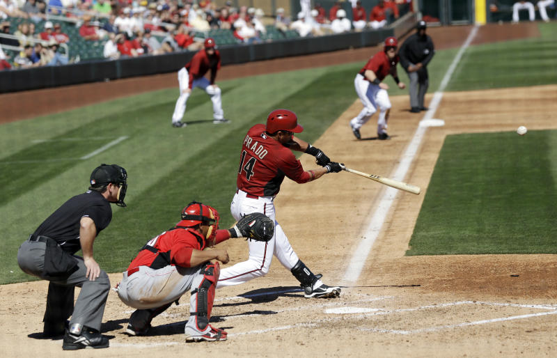 Arizona Diamondbacks' Martin Prado (14) drives in a run with a single against the Cincinnati Reds during the second inning of an exhibition spring training baseball game, Wednesday, Feb. 27, 2013, in Scottsdale, Ariz. (AP Photo/Marcio Jose Sanchez)