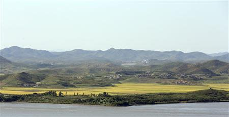 A North Korean village is seen across the Imjin River in this picture taken from an observation post in the south of the demilitarized zone in Paju