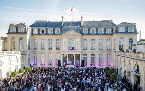 DJ Chloe plays music during the 'Fete de la Musique', the music day celebration in the courtyard of the Elysee Palace, in Paris - Credit: Reuters