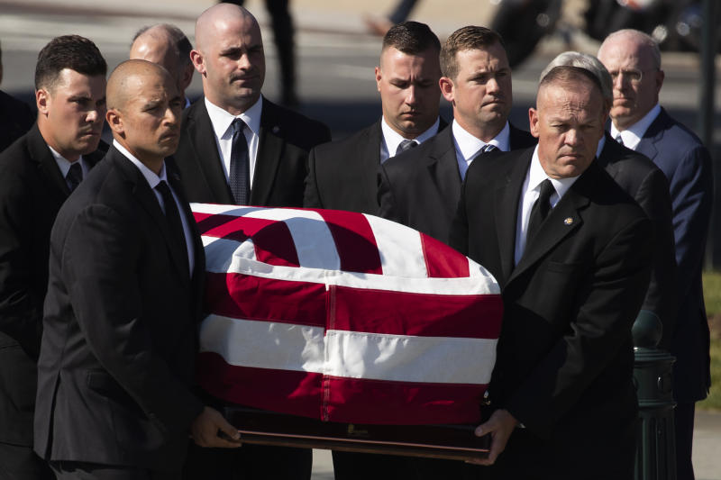 The casket of late Supreme Court Justice John Paul Stevens is carried into the U.S. Supreme Court in Washington, Monday, July 22, 2019. (AP Photo/Manuel Balce Ceneta)