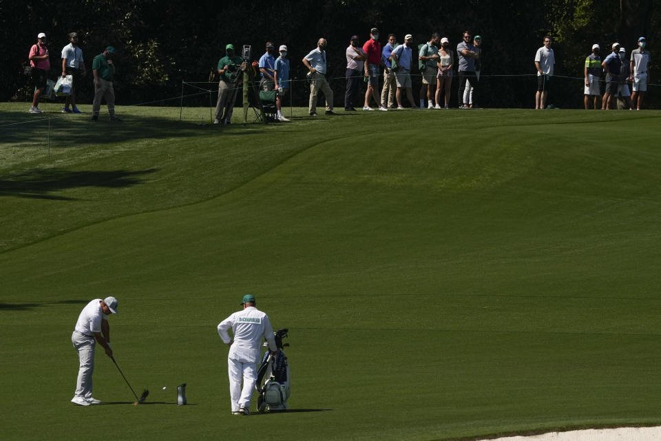 Bryson DeChambeau hits from the fairway on the second19 hole during a practice round for the Masters golf tournament on Monday, April 5, 2021, in Augusta, Ga. (AP Photo/Charlie Riedel)