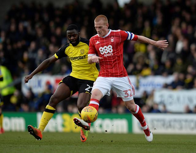 "Soccer Football - Championship - Burton Albion vs Nottingham Forest - Pirelli Stadium, Burton-on-Trent, Britain - February 17, 2018 Nottingham Forest's Ben Watson in action with Burton's Hope Akpan Action Images/Alan Walter EDITORIAL USE ONLY. No use with unauthorized audio, video, data, fixture lists, club/league logos or ""live"" services. Online in-match use limited to 75 images, no video emulation. No use in betting, games or single club/league/player publications. Please contact your account representative for further details."
