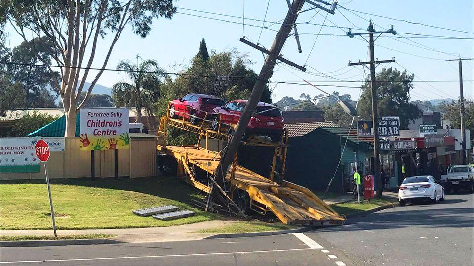 The car carrier took out a power pole before smashing through the fence of a Victorian childcare centre. Source: Supplied