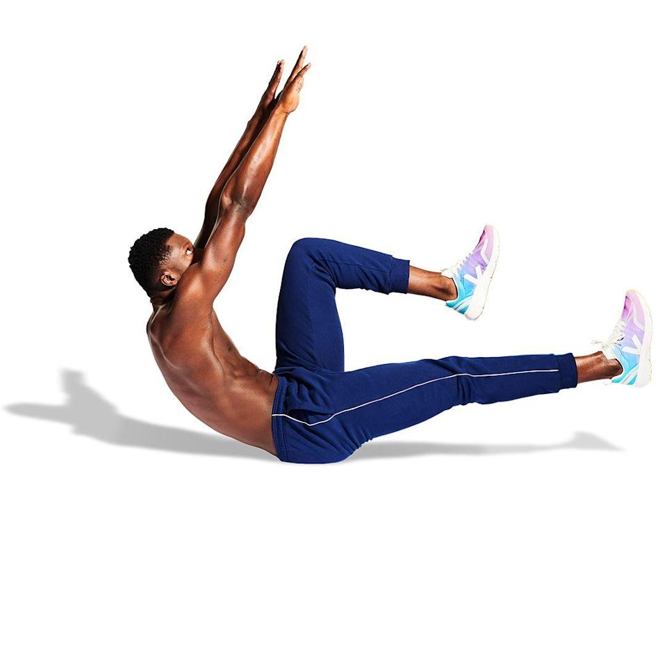 <p>Ensuring that your lower back is still pinned to the floor, bring your arms up to the starting position and crunch up, bringing your shoulders towards your hips.</p>