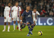 PSG's Neymar scores his side's first goal from the penalty spot during the French League One soccer match between Paris Saint-Germain and Lyon at the Parc des Princes in Paris Sunday, Sept. 19, 2021. (AP Photo/Francois Mori)