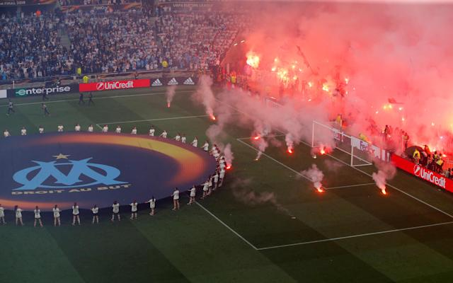 Soccer Football - Europa League Final - Olympique de Marseille vs Atletico Madrid - Groupama Stadium, Lyon, France - May 16, 2018 Flares land on the pitch at the Marseille end before the match REUTERS/Vincent Kessler