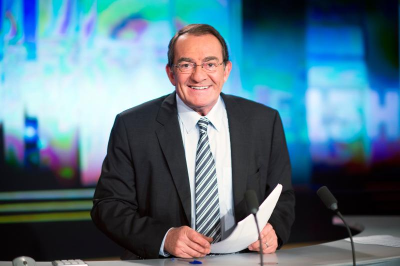 French TF1 Television national channel's anchorman Jean-Pierre Pernaut poses in a studio set on February 13, 2015 in Boulogne-Billancourt, near Paris. AFP PHOTO MARTIN BUREAU / AFP PHOTO / Martin BUREAU (Photo credit should read MARTIN BUREAU/AFP via Getty Images)