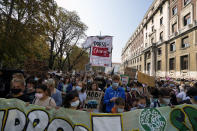 Students march as part of the Fridays for Future climate movement's initiatives, in Milan, Italy, Friday, Sept. 24, 2021. Environmental activists, many of them students taking time out from school, are staging rallies around the world to demand that leaders take stronger action to curb climate change. (AP Photo/Luca Bruno)