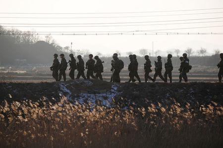 South Korean soldiers patrol near the demilitarized zone separating the two Koreas in Paju