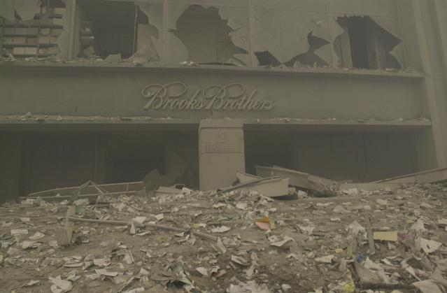 <p>A destroyed Brooks Brothers store near ground zero on Sept. 11, 2001, after terrorist attacks on the World Trade Center in New York City. (Photo: Mark Lennihan/AP) </p>
