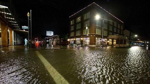 PHOTO: Water rises from the storm surge of Tropical Storm Beta in The Strand as the storm moves toward landfall, Sept. 21, 2020, in Galveston, Texas. (Brett Coomer/AP)