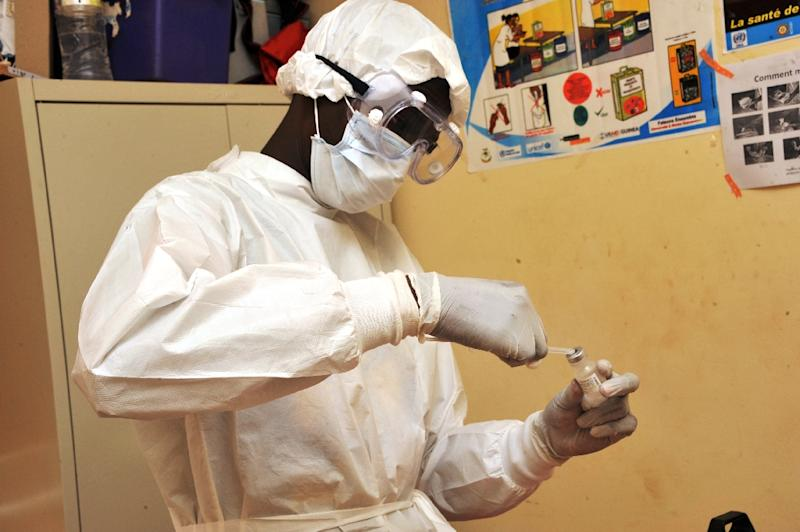 A health worker prepares a vaccination against the Ebola virus during clinical trials in Guinea in 2015 (AFP Photo/Cellou Binani)