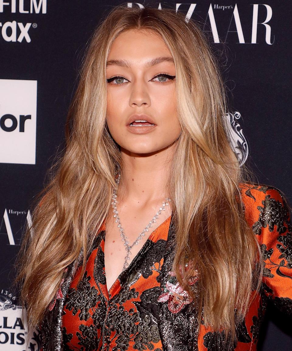 """Gigi served major Serena van der Woodsen vibes at the 2017 Harper's Bazaar Icons party with flowing undone waves and bold liner. <span class=""""copyright"""">Photo: Taylor Hill/FilmMagic.</span>"""