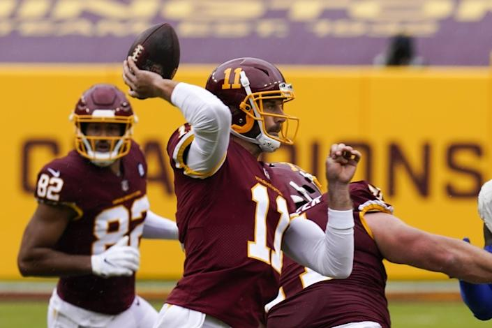 Washington Football Team quarterback Alex Smith throws during the first half of an NFL football game.