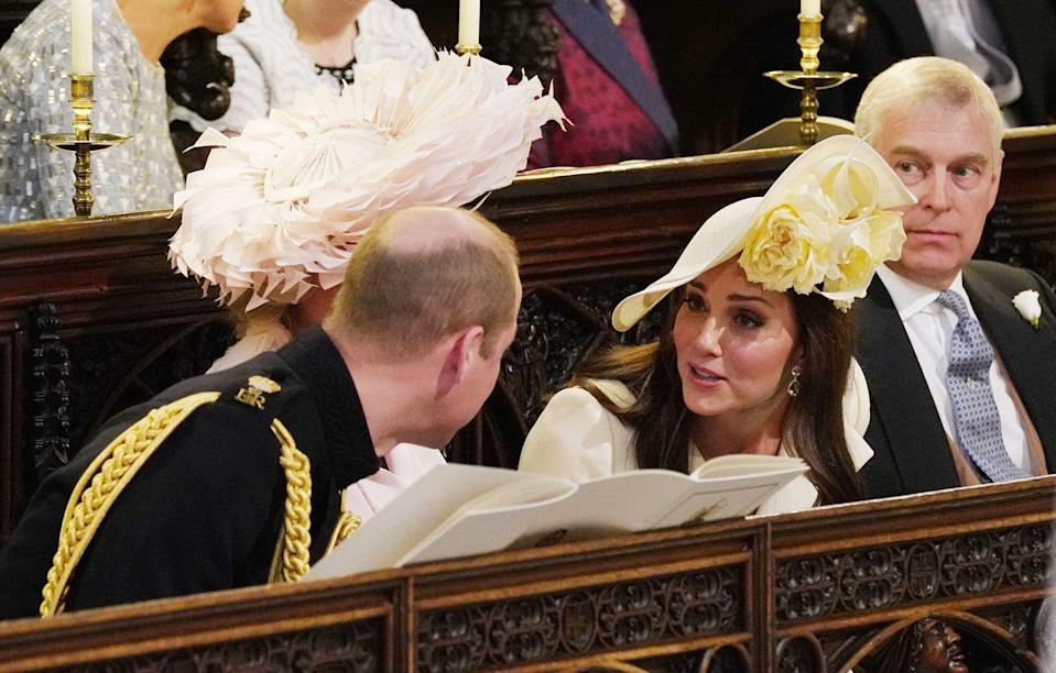 <p>Prince William and Kate Middleton are seen chatting it up in the chapel. </p>