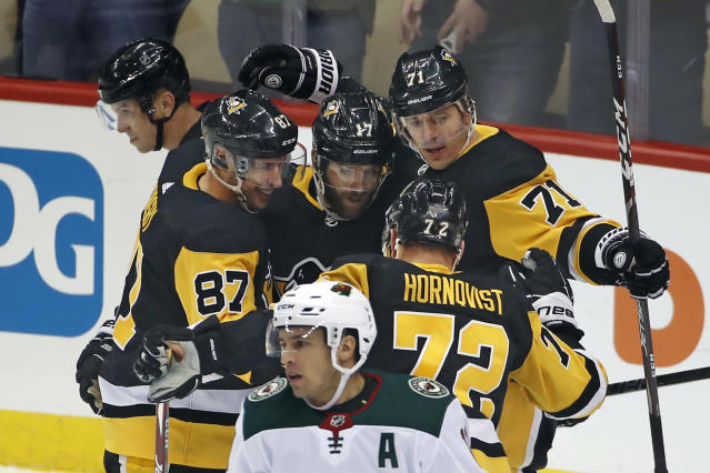 Pittsburgh Penguins' Evgeni Malkin (71) celebrates his goal with teammates, including Bryan Rust (17) and Sidney Crosby (87), during the first period of the team's NHL hockey game against the Minnesota Wild in Pittsburgh, Tuesday, Jan. 14, 2020. (AP Photo/Gene J. Puskar)