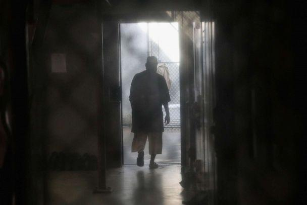 PHOTO: A prisoner walks to an outdoor area of the 'Gitmo' maximum security detention center on Oct. 22, 2016 at the U.S. Naval Station in Guantanamo Bay, Cuba. (John Moore/Getty Images, FILE)