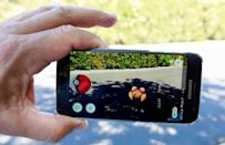 The augmented reality mobile game Pokémon Go by Nintendo is shown on a smartphone screen in this photo illustration. A couple from Kingsville, Ont., south of Windsor, has been fined for playing the game while parked in their vehicle during the COVID-19 lockdown.