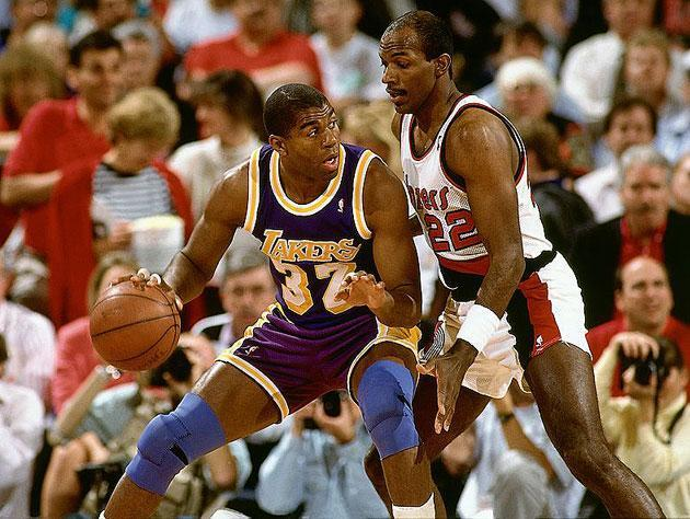 Magic Johnson and Clyde Drexler. (Getty Images)