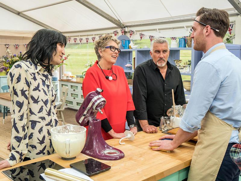 Noel Fielding (left), Paul Hollywood and Prue Leith give contestant Tom a grilling: PA