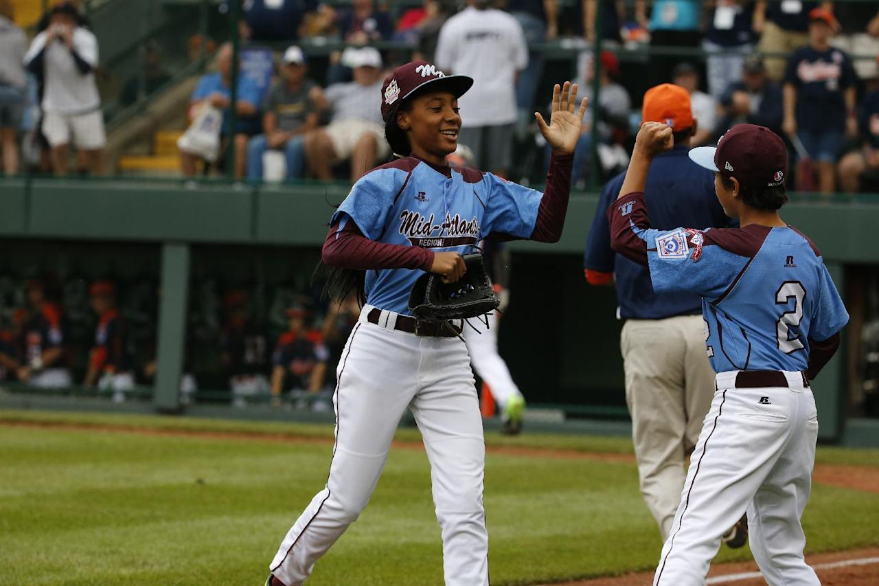 Pennsylvania pitcher Mo'ne Davis, left, celebrates with teammate Jack Rice (2) after getting the final out of a 4-0 shutout against Tennessee during a baseball game in United States pool play at the Little League World Series tournament in South Williamsport, Pa., Friday, Aug. 15, 2014. (AP Photo/Gene J. Puskar)