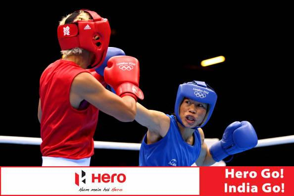 LONDON, ENGLAND - AUGUST 06:  Chungneijang Mery Kom Hmangte (Blue) of India competes against Maroua Rahali (Red) of Tunisia during the Women's Fly (51kg) Boxing Quarterfinals on Day 10 of the London 2012 Olympic Games at ExCeL on August 6, 2012 in London, England.  (Photo by Scott Heavey/Getty Images)