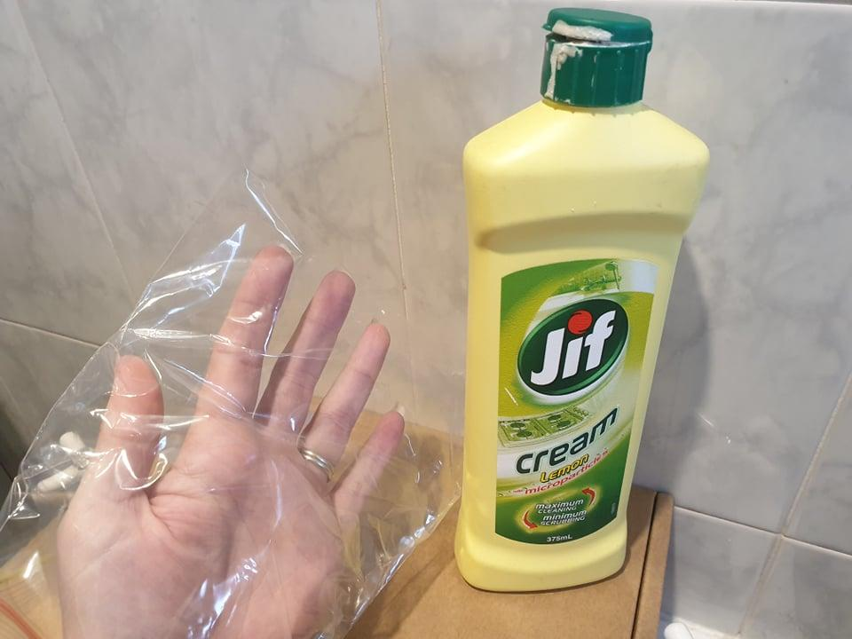 shower cleaning hack plastic bag and jif
