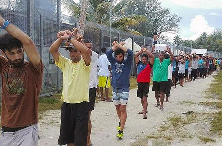An undated image released shows detainees staging a protest inside the compound at the Manus Island detention centre in Papua New Guinea