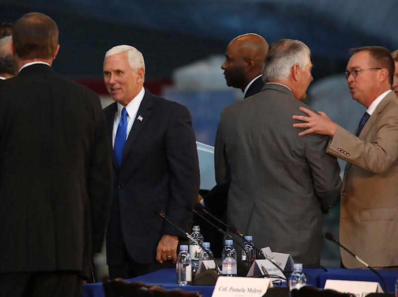"Mick Mulvaney (R), with Vice President Mike Pence (L), Secretary of State Rex Tillerson (C), has described the Consumer Financial Protection Bureau which he will lead as a ""sick, sad joke"""