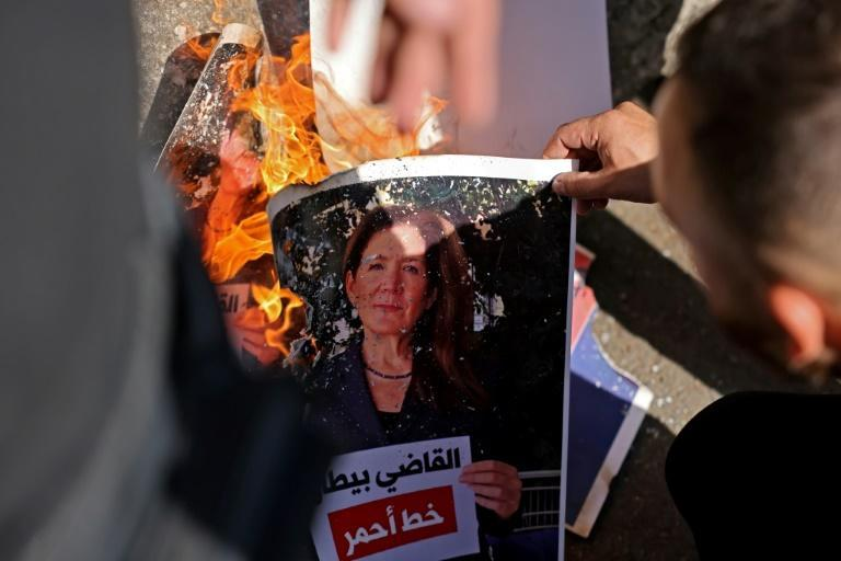 A Shiite protester burns a portrait of US ambassador Dorothy Shea at a rally near the Palace of Justice in the Lebanese capital (AFP/JOSEPH EID)