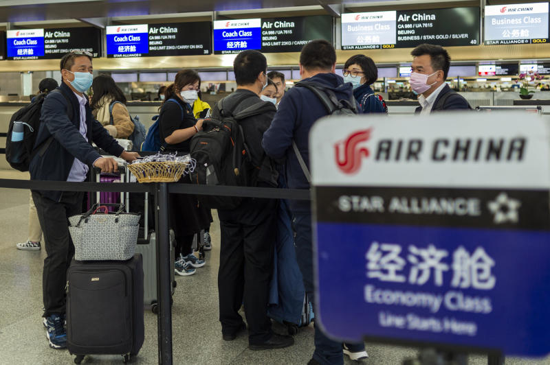 "Travelers wearing face masks line up at the Air China check in counter in the international terminal at the San Francisco International Airport in Millbrae, California, United States on February 2, 2020. Due to an outbreak of novel coronavirus in China, the United States government has declared a public health emergency and will implement strict travel restrictions effective today. Foreign nationals who have been in China in the last 14 days, and are not immediate family members of U.S. citizens or permanent residents, will be prohibited from entering the U.S. The World Health Organization (WHO) has declared the novel coronavirus, which has infected more than 14,647 people and killed at least 305, a global health emergency. U.S. State Department issued a ""Do not travel"" advisory urging Americans to avoid visiting China during the epidemic outbreak. Delta Airlines, American Airlines and United Airlines are suspending all flights between the U.S. and China. (Photo by Yichuan Cao/Sipa USA)"